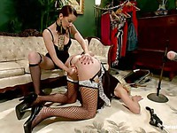 Maitresse Madeline humiliates a man while putting him into female clothes during femdom.