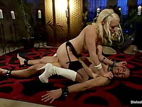 Fetish lover Lorelei Lee has her tattooed lover tied up and strapped while making him moan.