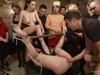 Marley Blaze in kinky metal bondage getting stretched and stimulated by fetish loving babes.