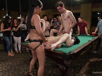 Lily Labeau and Isis Love are stripped while unknown men are using them during kinky bondage.