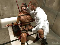 Ava Devine is in metal contraptions while her bondage master makes her moan during rough sex.